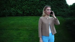 Young Beautiful Blond Female Talking on Phone Angry, Indignant, Expressed Claim