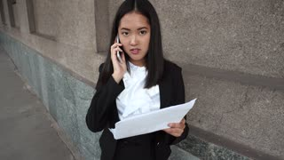 Young Beautiful Business Woman Female Girl Portrait Talk on Phone Call Hold Documents on Background Office Building Outdoor