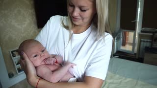 Young Beautiful Mother Hold Child Infant Newborn