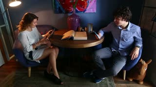 Young Smart Business Couple Using Tablet Technology Phone