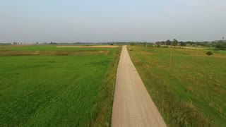 Flight Beyond Gravel Road In Countryside 1