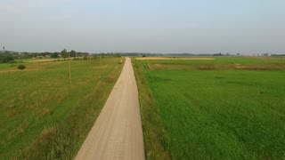 Flight Beyond Gravel Road In Countryside 2