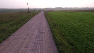 Flight Beyond Gravel Road In Countryside 6