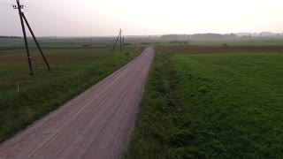 Flight Beyond Gravel Road In Countryside Backwards 1