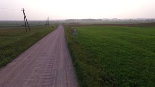Flight Beyond Gravel Road In Countryside Backwards 2