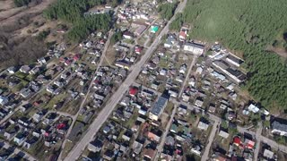 Flight Over Small Town Near Forest 1