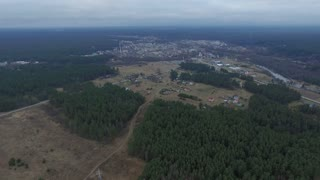 Flight Over The Forest And Small Town In Distance 1