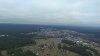 Flight Over The Forest And Small Town In Distance 2