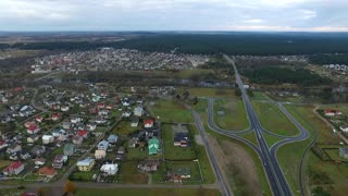 Flight Over The Forest And Small Town In Distance 6