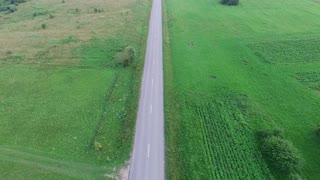 Flying Over Country Road, Car Passing By 1