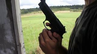 Man Cocking The Handgun