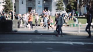 Anonymous people crowd street crosswalk. City life. Child on self balancing electric scooter, bicycles and walking people