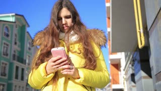 Beautiful woman using smart phone technology app walking through city streets living urban happy lifestyle