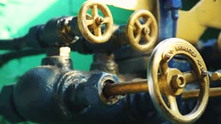 Closeup of pipes and faucet valves of heating system in a steam train
