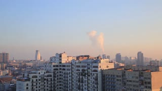 Kiev City buildings, overhead aerial shot with pipes pollution at sunset