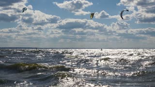 Kite surfing in waves. Static wide angle shot