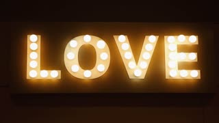 Love word made of glowing light bulbs