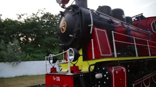 Steadycam fly around shot of historic retro steam train in the forest