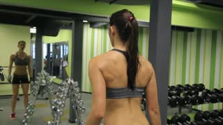 Adult woman exercising with weights in gym. Healthy lifestyle