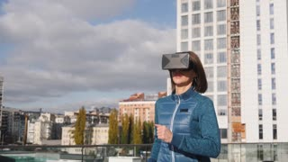 Athletic fitness woman running in urban city with vr virtual reality hi-tech headset on