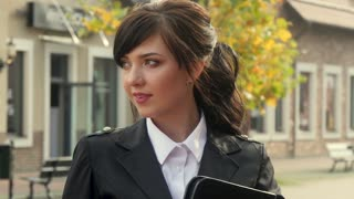 Beautiful smiling business woman on the background of the modern office. Holding tablet. Appartment rental agent concept