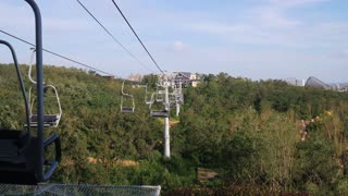 Beautiful view from ropeway car moving in the mountain.