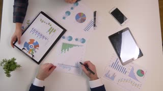 Business team meeting discussion. Professional investor working with new startup project. Finance managers task. Digital tablet laptop computer smarphone and finance charts