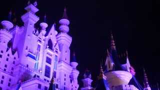 Fantasy landscape with the fairytale castle at night with cloud sky at background.