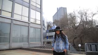 Fashion happy woman tourist walking in the city. Multiethnic hispanic latina woman in her 20s