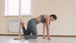 Fitness female doing stretching workout on exercise mat. Young woman exercising on fitness mat indoor. 4k slow motion