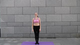 Fitness yoga woman athlete warming up jumping before doing sports, slow motion