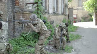 Guerilla partisan warriors operation in urban environment. War battlefield maneuvers training