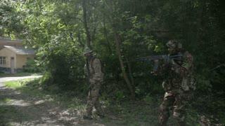 Guerilla partisan warriors operation in urban environment. War battlefield maneuvers training
