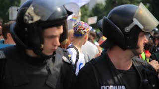KYIV, UKRAINE - 18 JUNE: Police security guards on gay parade march in Kiev with boy in Gay t-shirt on background