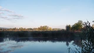 Landscape timelapse of beautiful picturesque sunrise sky over river. 4k UHD