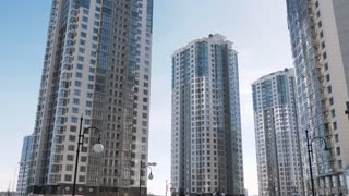Low angle establishihg shot of modern residential area buildings architecture apartment.