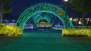 Street festival decoration with colorful Christmas LED lights for new year holidays.