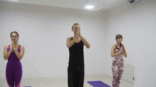 Yoga class group exercising healthy lifestyle in fitness studio yoga warrior poses