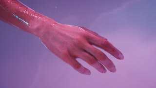 Young womans hand floating in Spa bath or swimming pool, she is very relaxed. Welness concept.