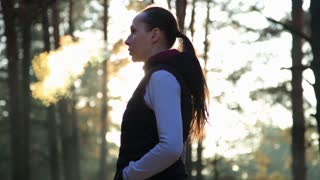 Young woman after jogging outside in sunny winter day. Steam from mouth. Healthy life style concept