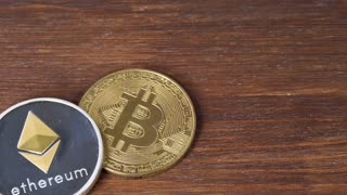 BitCoin BTC and Ethereum ETH coin on brown wooden surface. Digital money on mining farm in digital cyberspace. Crypto currency, quotes online concept, stock exchange, exchange market