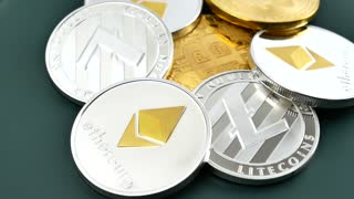 BitCoin BTC, Ethereum ETH and Litecoin LTC coins are rotates. Worldwide virtual internet cryptocurrency and digital payment system. Digital coin money on mining farm in digital cyberspace