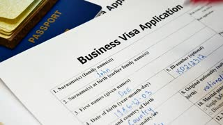 Decision to refuse to grant a Business Visa. Hand writes denied at application form