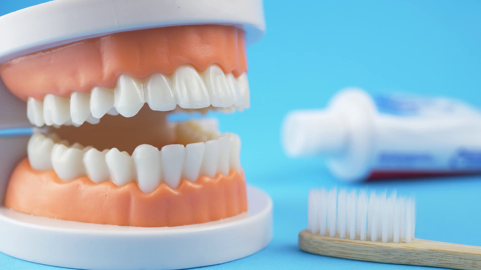 Dentist Teaching How To Brush Teeth By White Bamboo Toothbrush On Back Blue Background With Toothpaste Concept Dental Hygiene Stock Video Footage Storyblocks