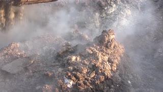 Earthwork in winter. Excavator digs the earth