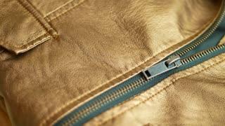 Elegant golden brown man's leather jacket with zipper