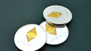 Ethereum ETH coins are rotates. Worldwide virtual internet cryptocurrency and digital payment system. Digital coin money on mining farm in digital cyberspace