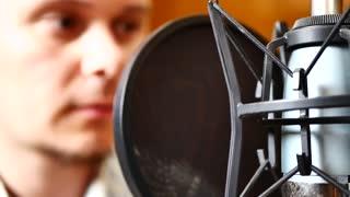Handsome happy radio dj host moderating in studio