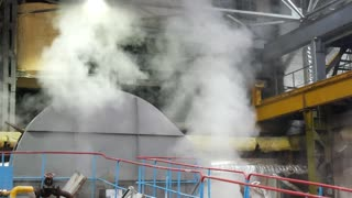 Hot steam on sugar refinery plant indoors