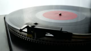 Spinning Record Player With Vintage Vinyl. Turntable Player And Vinyl Record With Dropping Stylus Needle Running Old CD And Playing Music on White Background